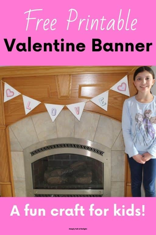 Free Printable Valentine Banner, a fun craft for kids!  - pic of child with completed banner