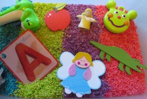 alphabet rainbow noodle sensory bin