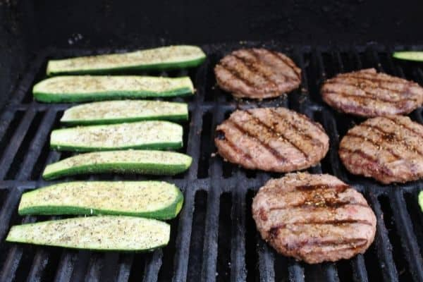 zucchini on the grill, seasoning side up first.