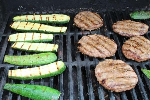 grilled zucchini on the grill with hamburgers