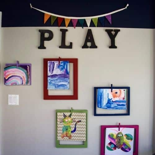 Kids art display wall by The organized mama