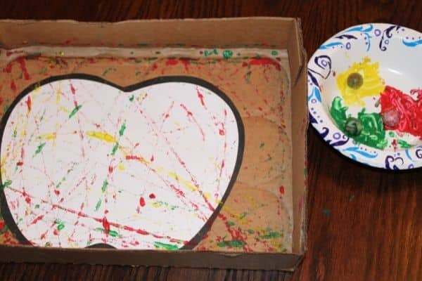 Marble painting apple craft in a box with paint and marbles